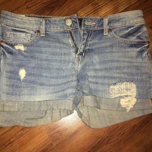 Made to look worn/distressed jean shorts